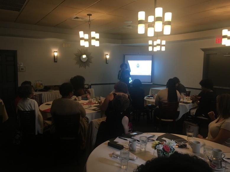 STEAM Train President, Donna Hylton speaks as the keynote speaker at an Women of Empowerment
